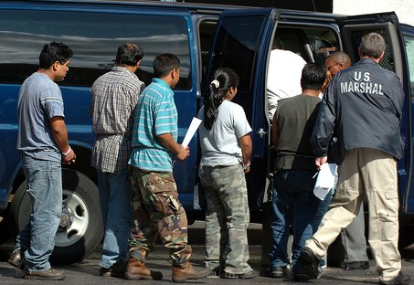 Detainees netted in a Department of Homeland Security Immigration and Custom Enforcement raid at Howard Industries manufacturing plant in Laurel, Miss. are escorted out of the Federal court house in Hattiesburg, Miss., Tuesday, Aug. 26, 2008. Federal officials say nearly 600 suspected illegal immigrants were detained in a raid on a manufacturing plant in southern Mississippi, making it the largest such sweep in the country. (AP Photo/Matt Bush, The Hattiesburg American)